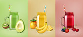 Realistic vector fruit smoothie posters. Mason jars with fruits and berries. Glasses of lemonade, smoothies or cold drinks. Avocado, kiwi, mango, banana, pineapple, strawberry, blueberry, cherry
