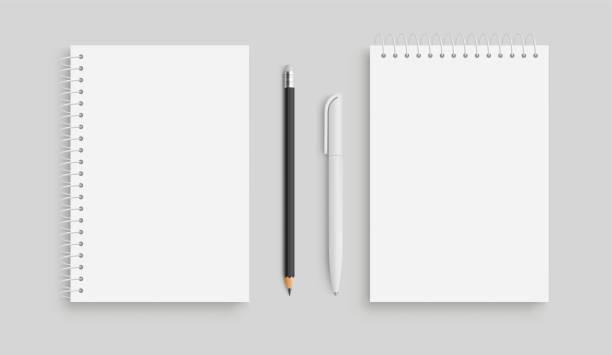 realistyczny notatnik wektorny i biały pancil, pióro. widok z przodu. - wektor zapasów. - notes stock illustrations
