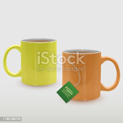 Realistic yellow and orange tea cups, tea mugs on white background, vector illustration