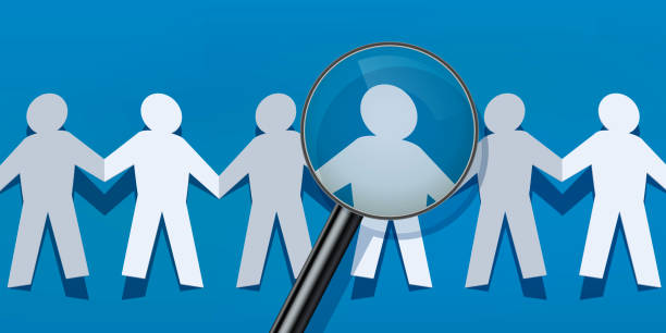 Recruitment symbolized by paper characters who hold hands and are scrutinized. vector art illustration