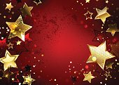 Red textured background with sparkling golden stars. Design with gold stars.