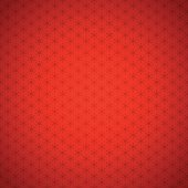 Seamless background with stylized snowflakes on red background with vignette