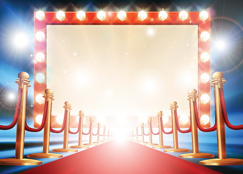 Red carpet background with theatre or cinema style light bulb sign