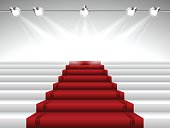 Vector illustration representing perspective  illuminated red carpet with stairs leading to stage under spotlights. File includes high rsolution JPEG.