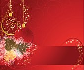 Red and gold christmas background with baubles.