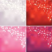 Set of four backgrounds with defocused lights: white, red, pink and purple.
