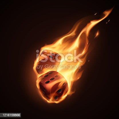 istock Red dice in fire on black background 1216158866
