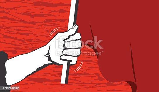 An arm raising high a red flag.