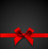 istock Red Gift Bow with Ribbon on a Black Background 1188221781
