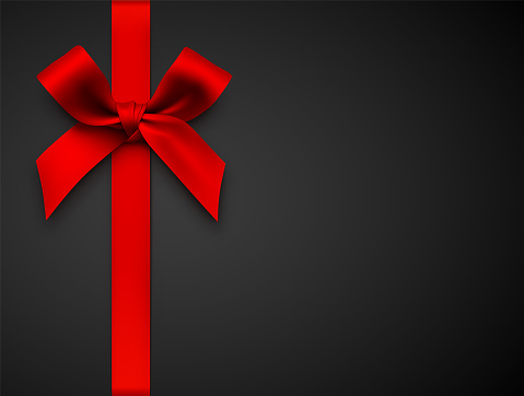Red Gift Bow with Ribbon on a Black Background