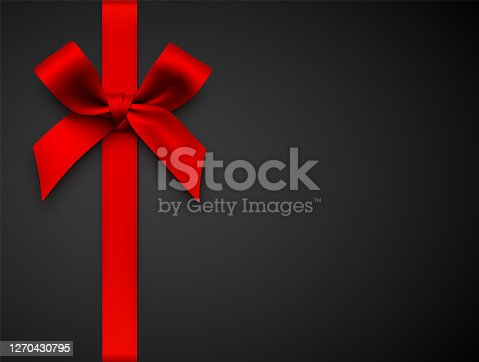 istock Red Gift Bow with Ribbon on a Black Background 1270430795