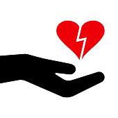 Red heart in black hand. Broken heart. Vector illustration