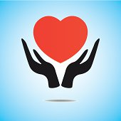 Red heart on hand, vector icon