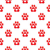 Vector seamless pattern of red paw prints with white hearts on them.