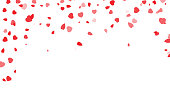 Red hearts petals falling on white background for Valentine's Day, shape of heart confetti background. Valentines Day, shape of heart confetti background.
