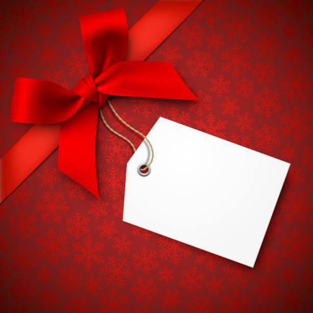 rot weihnachten hintergrund mit roter schleife und anhänger - weihnachtsgeschenk stock-grafiken, -clipart, -cartoons und -symbole