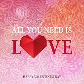 Celebrate Valentine's Day with LOVE words and paper art red heart on pink floral background