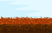 istock Red mulch background with copy space. Landscape design color mulch. 1217555871