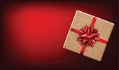 Red Christmas background with gift box and bow. Vector top view illustration.
