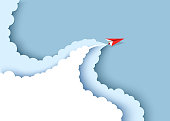 Red paper airplane flying on the blue sky and cloud. Paper cut art style of business success and leadership creative concept idea. Vector illustration