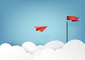 Red paper airplanes flying to red flag on blue sky and cloud.Paper art style of business success and leadership creative concept idea.Vector illustration