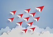 leadership concept with red paper plane on blue sky.paper art style.