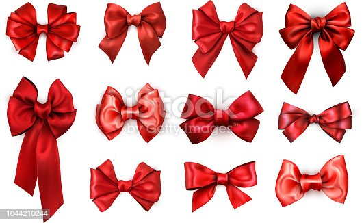 Set of red realistic beautiful satin bows for gift isolated on white. Vector illustration.