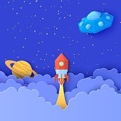 istock Red rocket launch in space in paper cut style. Galaxy universe landscape 3d craft background with Flying saucer in starry sky clouds. Cardboard cutout Saturn planet and UFO. Vector kids illustration 1257899812