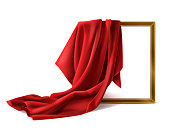 Red silk cloth cover wooden painting frame isolated on white background. Fabric drapery curtain and empty picture or photo border mockup for gallery presentation. Realistic 3d vector illustration