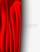red silk with a shadow on a light background