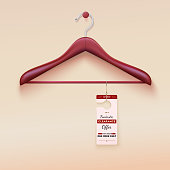 Red tag with special offer sign, wooden hanger