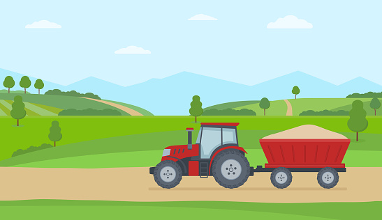 Red tractor with trailer on rural landscape background.