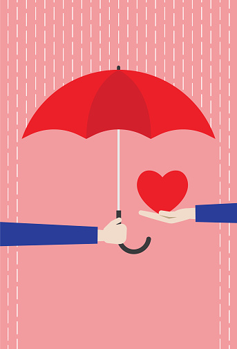 Red umbrella protecting the heart from rain