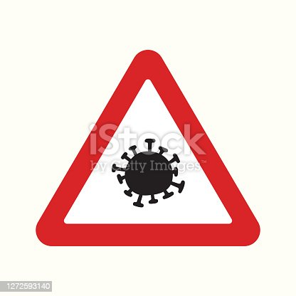 istock Red warning road sign with corona virus icon on it. 1272593140