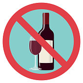Refusal of alcohol, stop alcohol. A bottle of wine with a glass is crossed out with a red line.