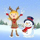 Little girl wearing reindeer horn to celebrate christmas holidays with the snowman.