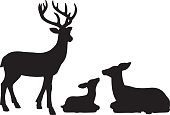 Vector silhouettes of a family of reindeers.