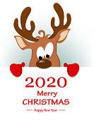 Reindeer standing behind placard with greetings