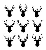 Reindeers with antlers silhouette flat vector illustrations set. Deers head with horns isolated on white background collection. Christmas season festive animal symbol design elements pack.