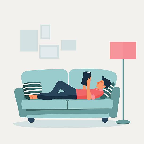 illustrazioni stock, clip art, cartoni animati e icone di tendenza di rilassata giovane uomo leggendo un libro su un divano - uomini giovani