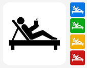 Relaxing Stick Figure Icon. This 100% royalty free vector illustration features the main icon pictured in black inside a white square. The alternative color options in blue, green, yellow and red are on the right of the icon and are arranged in a vertical column.