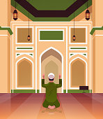 religious muslim man kneeling and praying inside mosque building ramadan kareem holy month religion concept rear view full length vertical vector illustration