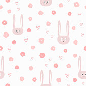Repeated flowers, hearts and heads of funny rabbits. Cute seamless pattern for girls. Endless girlish print. Sweet vector illustration.