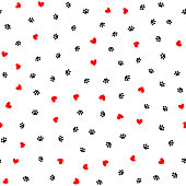 Repeated hearts and footprints of animal. Cute seamless pattern.