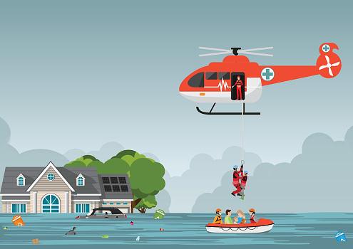 Rescue team with rescue helicopter and boat rescue in mission rescue at sea or flood.