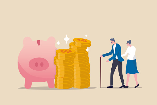 Retirement mutual fund, 401k or Roth IRA savings for happy life after retire and financial freedom concept, rich senior couple elderly man and woman stand with stacked of dollar coins pink piggy bank.