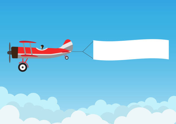 retro airplane flying with advertising banner on blue sky - vector illustration - airplane stock illustrations, clip art, cartoons, & icons