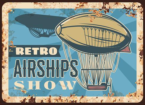 Retro airships rusty metal plate, dirigibles show