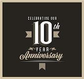 istock Retro and Vintage 10 Year Anniversary Label design on black background 1321022949