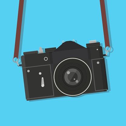 Retro camera hung. Vintage old, antique photocamera with strap. Vector illustration